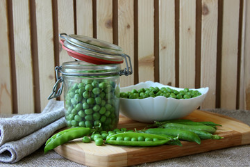 Bank, filled with peas and a plate full of peas.