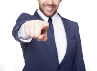 Smiling business man pointing the finger at you, isolated on whi