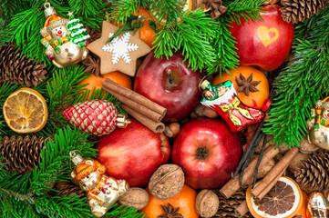 Christmas ornaments and decorations. Apples, mandarin fruits, wa