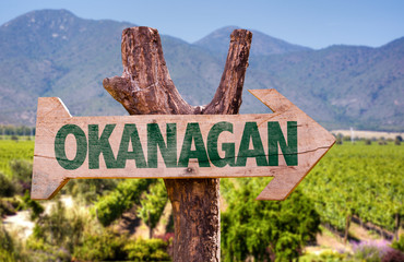 Okanagan wooden sign with winery background
