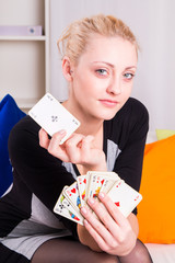 Portrait of a girl playing cards at home