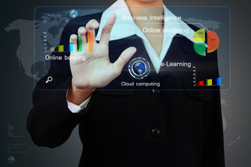 Wall Mural - businessman present a business graph on virtual screen