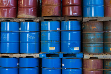 Rows of stacked steel barrels of various colors