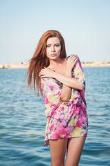 Sensual redhead summer holiday concept
