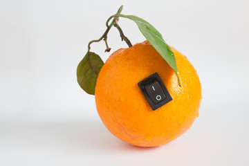 Single orange with switch in power off position on light grey ba