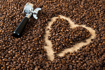 heart in a lot of coffee beans with heart