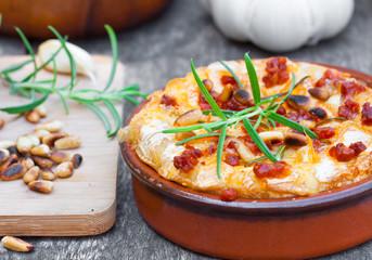 baked camembert with chorizo garlic rosemary fried pine nuts
