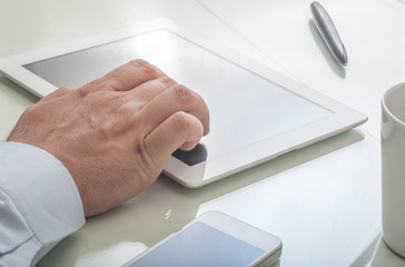 Businessman using tablet device