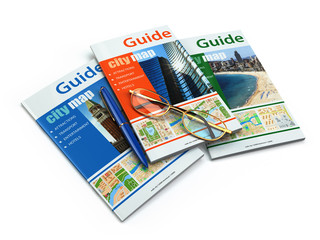 Travel guide books on white isolated background.