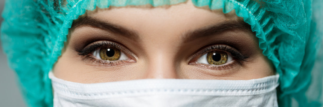 Female doctor's face wearing protective mask