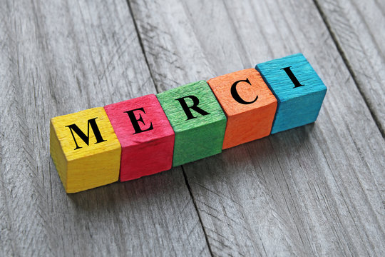 word merci (thank you in french) on colorful wooden cubes