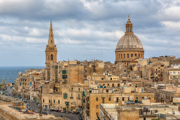 View to Valetta city buildings under clouds