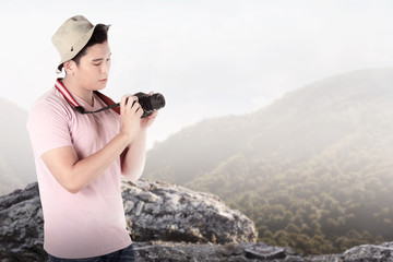 A tourist taking image with camera