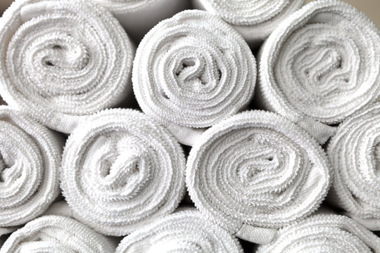 rolled white body towels, beautiful background