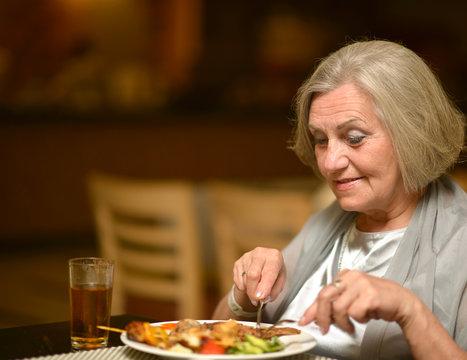 Senior woman having dinne