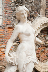 White stone statues and sculptures in the external courtyard of the olimpic theater in Vicenza