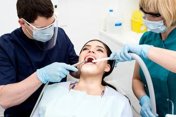 Dentist examining a woman teeth