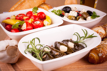 Vine leaves stuffed with peppers and Mediterranean antipasto