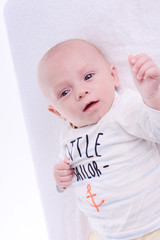 isolated portrait of young happy smiling baby on a white background