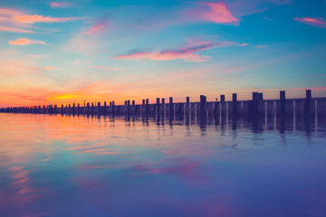 Pier over ocean at sunset, Long Island NY
