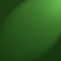 Green felt background illuminated by a spotlight