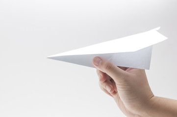 woman's hand take the paper plane