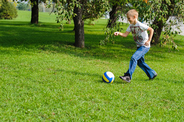 Young boy playing football outdoors