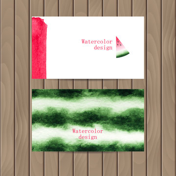 Vector business card with the watercolor texture of watermelon on a wood background