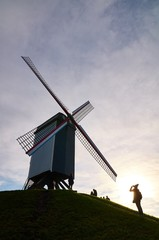 Taking pictures at a windmill in Bruges, Belgium