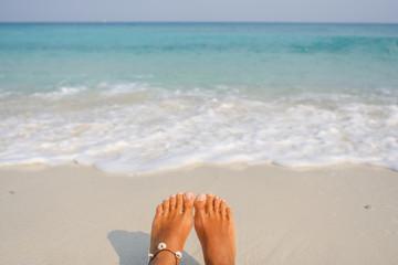 Woman's Bare Feet on the beach.