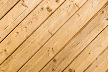 Sichtschutz aus schrägen Holzlatten, Hintergrund