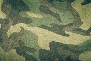 Fabrics with camouflage pattern. Background. Toned