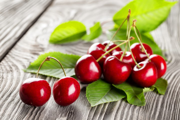 Bunch of ripe sweet cherries with leaves