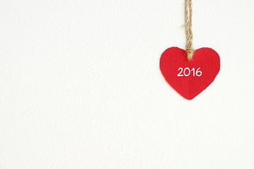 Red fabric heart with 2016 word hanging on the clothesline