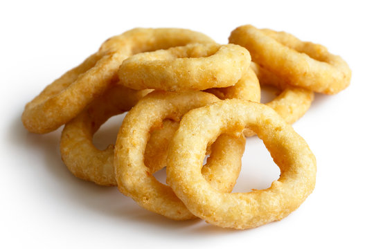 Heap of deep fried onion or calamari rings isolated on white.