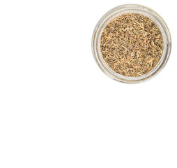 Dried thyme herbs in a mason jar over white background