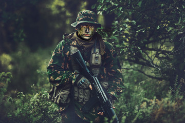 soldier in forest area at twilight
