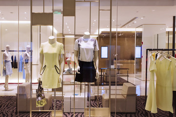 mannequins and clothes in fashion shop