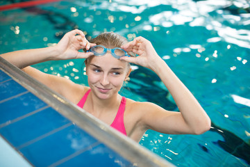 Female swimmer in an indoor swimming pool - doing crawl (shallow