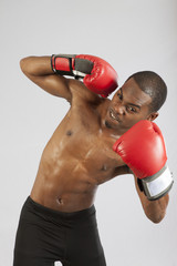 Black man with boxing gloves on