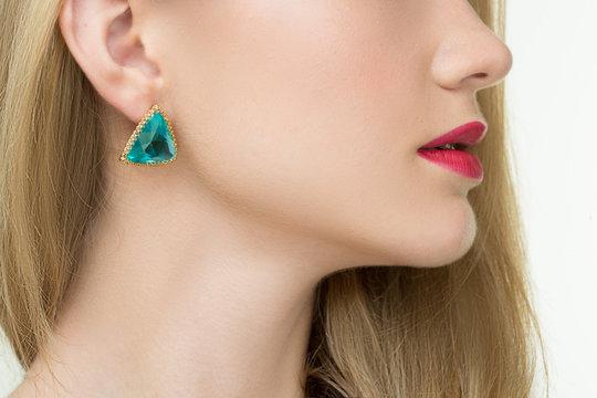 close up of woman wearing shiny diamond earrings