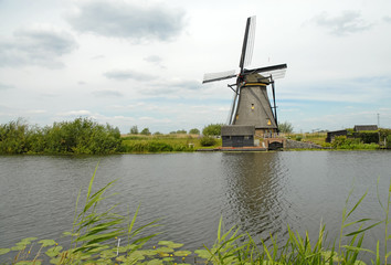 Vintage wooden Windmills in Kinderdijk, Holland / Netherlands