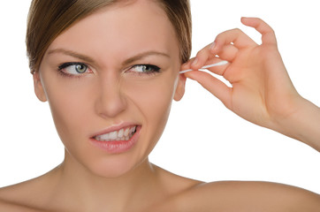 woman injured cleans ears with cotton sticks
