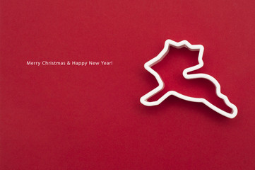Christmas card with mold of reindeer for baking. Look through my