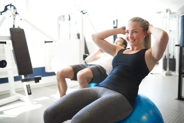 Fit Young Woman Doing Sit-ups on Exercise Ball
