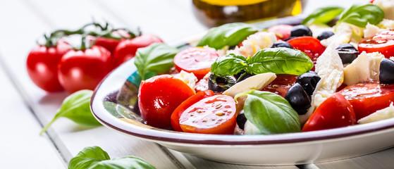 Caprese. Caprese salad. Italian salad. Mediterranean salad. Italian cuisine.  Wall mural