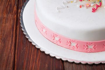 Fondant cake/Flower themed cake on wooden table