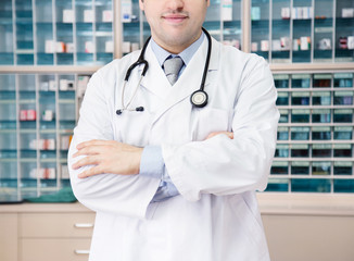 Medical doctor in front of medicine cabinet. professional job.Healthcare.