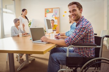 Creative casual businessman in wheelchair