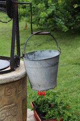Bucket at the well / Bucket of a water well